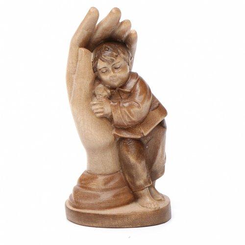 mano protettiva con bimbo legno valgardena multipatinato